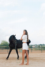 Serene Woman With Horse In Countryside