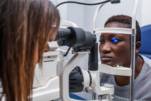 Black Woman In Optometry Cabinet Using A Retinograph