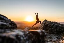 Woman Doing Yoga Outdoors At Sunset Light