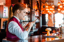 Content Barkeeper Taking Photo Of Cocktail In Bar