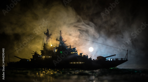 Canvas Silhouettes of a crowd standing at blurred military war ship on foggy background