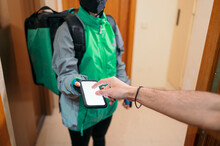 Man Paying For Delivery During Pandemic