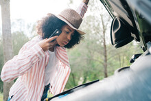 Black Woman Having Troubles With Car During Trip In Nature