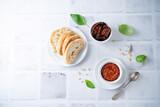 Fototapeta Kawa jest smaczna - Dried tomatoes nuts pesto in a bowl