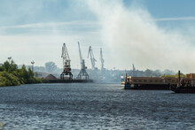 Small River Port With Industrial Cranes