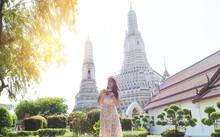 Traveler Woman On Boat Joy View Wat Arun At Sunset, Chao Phraya River, Famous Water Landmark Travel Bangkok Thailand