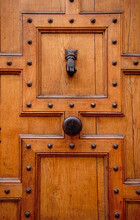 Large Panneled And Studded Door With Iron Knob And Knocker
