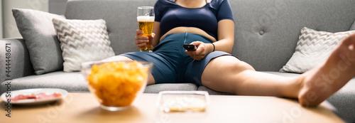 Tela Overeating Junk Food, Drinking Beer