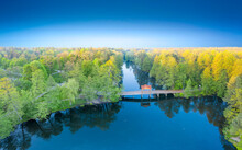 Dawn Over The Lake By Forest And River. Drone View, Aerial Photo.