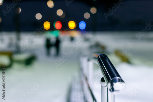 Fotografering metal railing in the foreground background blurred lights of lanterns of differe