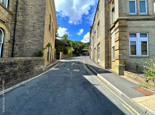 Looking up, Rise Lane with stone Victorian buildings in the centre of, Todmorden Fototapet