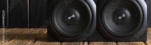 Obraz na plátně A two-way mid-range speaker system installed in a natural pine interior