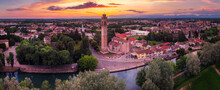 Aerial View Of The Casale Sul Sile Church And Harbour On The River Sile At Sunset. On The Left The Medieval Carraresi Tower.