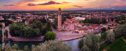 Billede på lærred Aerial view of the Casale sul Sile church and harbour on the river Sile at Sunset
