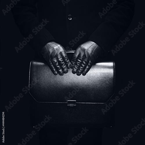 Fotografía Concept a business person holding a briefcase.