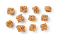 Brown Cane Sugar Cubes Placed On A White Background.