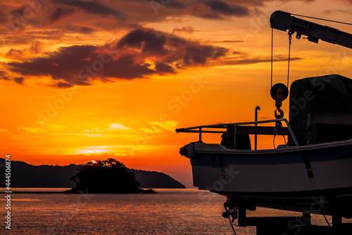 博多湾の夕日 Fotobehang