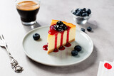 Fototapeta Kawa jest smaczna - Dessert - piece of New York Cheesecake with blueberry sauce and fresh berry.