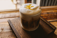 Iced Coffee With Milk Foam And Spice On Top In The Cafe.