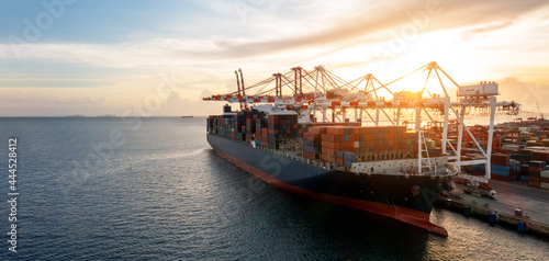 Fotografie, Obraz Cargo container ship  loading cargo by smart crane at the international terminal container depot yard port concept freight shipping transportation and smart logistic technology service