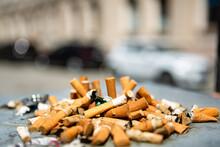 Cigarrete Butts Closeup In A Public Ashtray