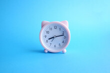 Cute Pink Alarm Clock With Cat's Ears On Bright Blue Background. Good Morning Or Wake Up Concept.