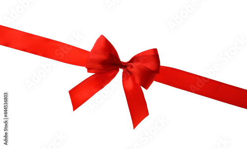 Photographie Red ribbon with bow on white background. Festive decoration