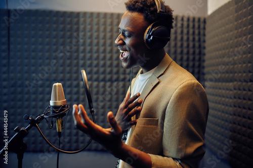 Slika na platnu Male singer sings a song, recording studio