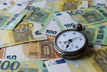 A Stopwatch On Mixed Euro Notes As A Background