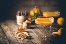 Pumpkin And Orange Spiced Fall Cocktail With Cinnamon
