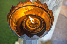 Blurred Abstract Background Of Flames Lit In Incense Burners, For People To Come To Make Merit Or To Light Up The Night.