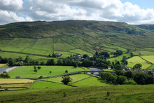 A View Looking South Over Burnsall Bridge Toward Burnsall And Thorpe Fell, In The Yorkshire Dales, North Yorkshire.