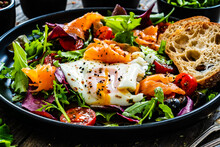 Salmon Salad - Smoked Salmon, Sunny Side Egg And Green Vegetables On Wooden Table