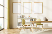 Three Posters In The Greenish Yellow Waiting Room Corner With Table
