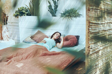 Beautiful Young Woman Sleeping In Domestic Bed In The Morning