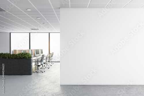 Wallpaper Mural Modern concrete coworking office interior with furniture, window with city view, daylight and empty mockup place on wall