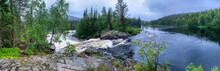 Giant Panorama Of The River Expanses. Waterfall Among The Stones. Island With Coniferous Trees. Taiga On The Horizon. The Blue Sky Is Reflected In The Water. Stone Banks. North. Karelia.