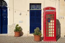 MARSAXLOKK, MALTA - 03 JAN, 2020: Classic Red British Telephone Box At The Traditional Fishing Village Of Marsaxlokk
