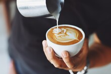 Hand-holding A Cup Of Coffee, Pouring Coffee Into A Cup, Drawing Pictures With Milk In The Coffee, Different Presentation In A Coffee Cup.