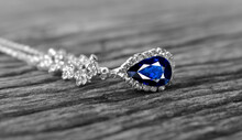 Necklace Is White Gold Decorated With Sapphires And Diamonds.