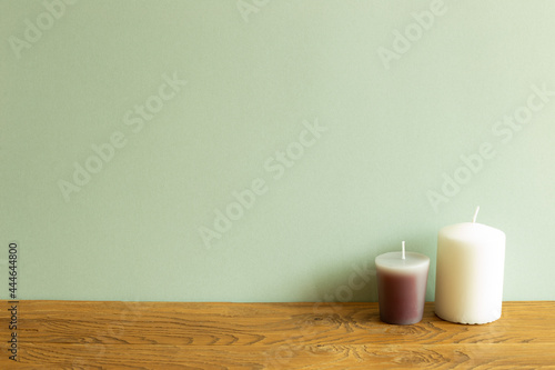Fotografie, Obraz Color candles on wooden table