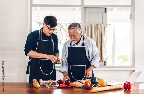 Tela Portrait of happy love asian family senior mature father and young adult son hav