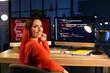Leinwandbild Motiv Female programmer working in office at night