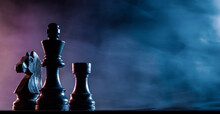 Chess Pieces On A Dark Background