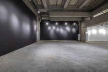Empty Interior Of Large Concrete Room As Warehouse Or Hangar With Spotlights