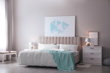 Cozy Bed With Soft Linens In Light Room