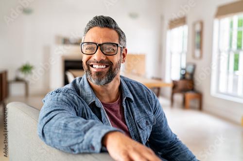 Obraz na plátně Mature ethnic man wearing eyeglasses at home