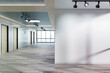 Leinwandbild Motiv Blank wall in office mockup with large windows and sun passing through 3D rendering