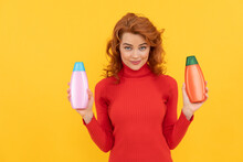 Smiling Redhead Lady Curly Dyed Hair Choosing Body Care Product Of Shampoo Bottle, Choice