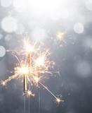 Fototapeta Kawa jest smaczna - Glittering sparklers, Merry Christmas and Happy New Year
